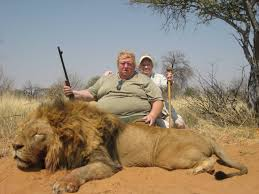 Obese Hunter 'Tests His Courage' Against Distant, Limping, Near Blind Lion