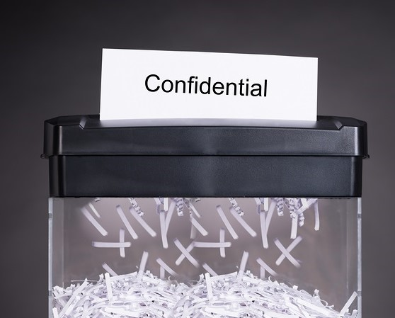 We May Never Know The Truth, Says Minister Feeding Documents Into Paper Shredder